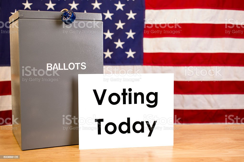 Ballot box with USA flag and 'Voting Today' sign. stock photo