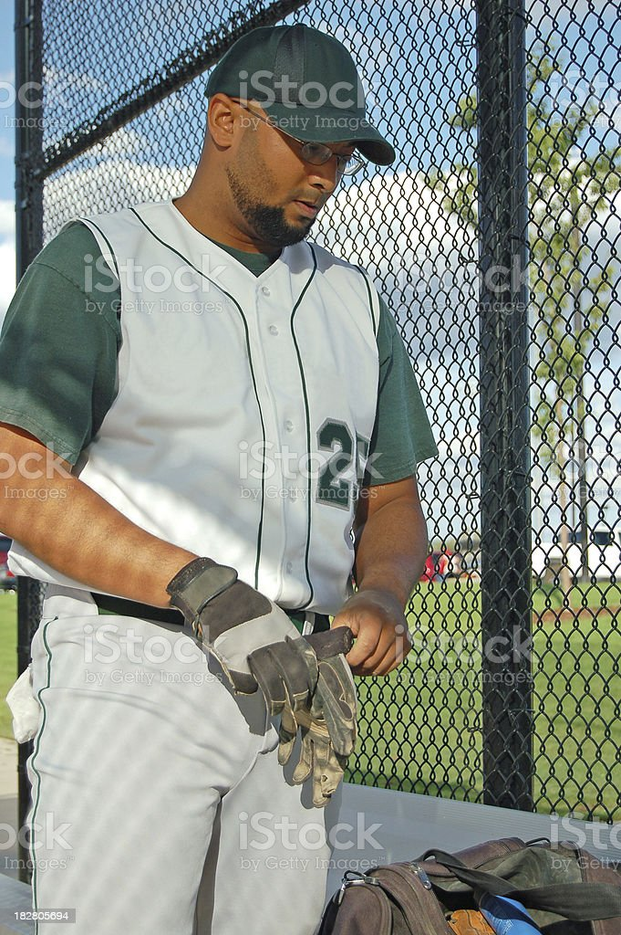 Ballplayer Puts on Gloves royalty-free stock photo