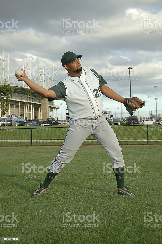 Ballplayer Throws in the Ball royalty-free stock photo