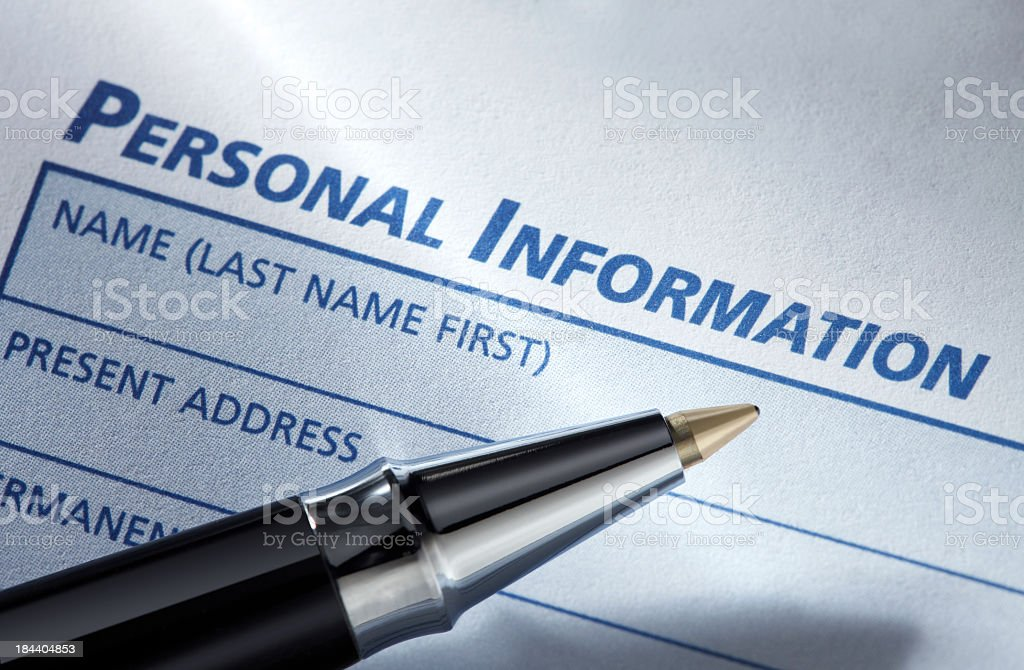 Ballpoint pen and a personal information request form stock photo