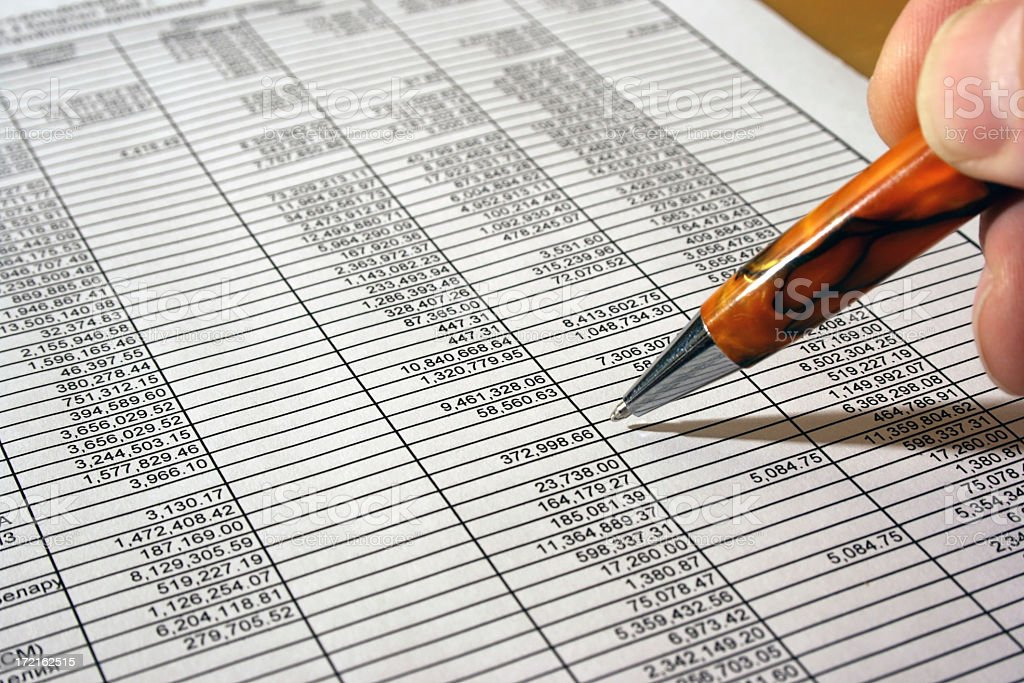 Ballpoint pen going over a sheet of numbers for calculation royalty-free stock photo