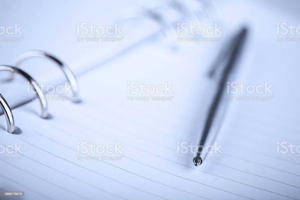 Ballpoint Pen on Notebook stock photo