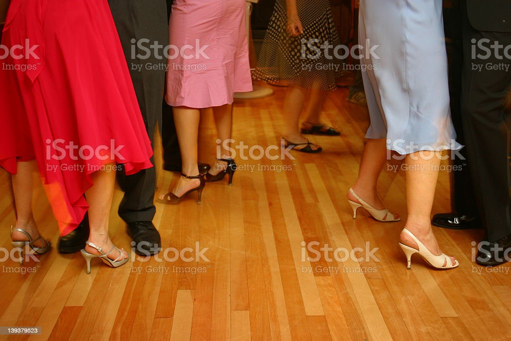 Ballroom dancing couples on hardwood floors stock photo