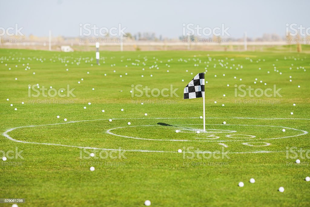 Balls for golf and a hole with a flag. stock photo