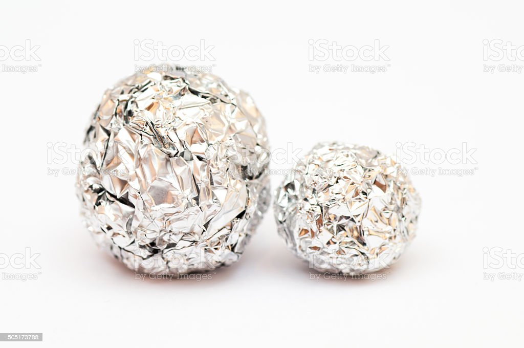 Balls made of tine foil next to each other stock photo