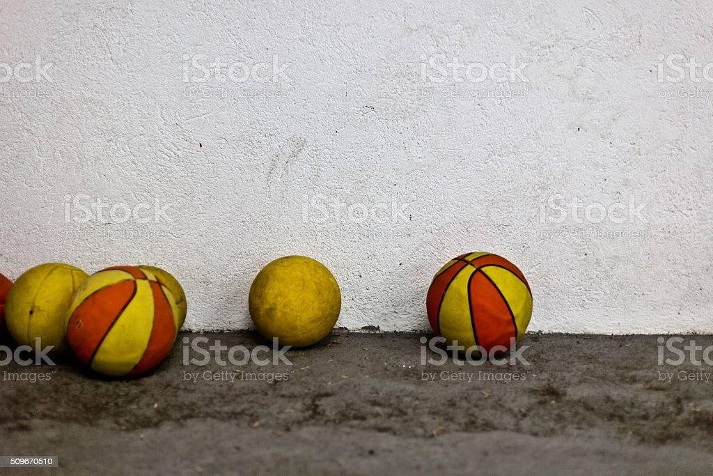 balls near to a textured wall stock photo