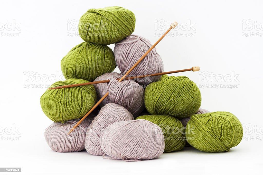 Balls of merino wool with bamboo knitting needles, white background stock photo