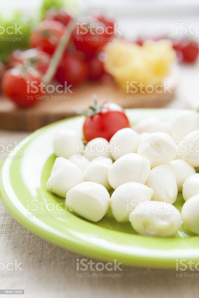 balls of mozzarella cheese and cherry tomatoes royalty-free stock photo