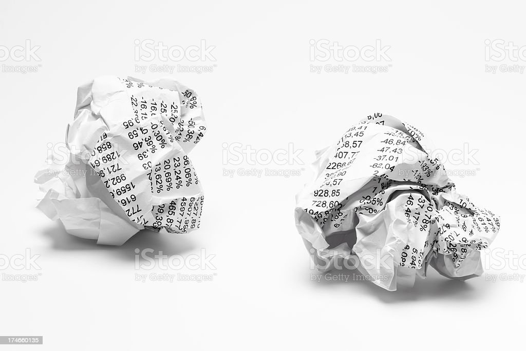 Balls of paper with financial figures. Isolated on white royalty-free stock photo
