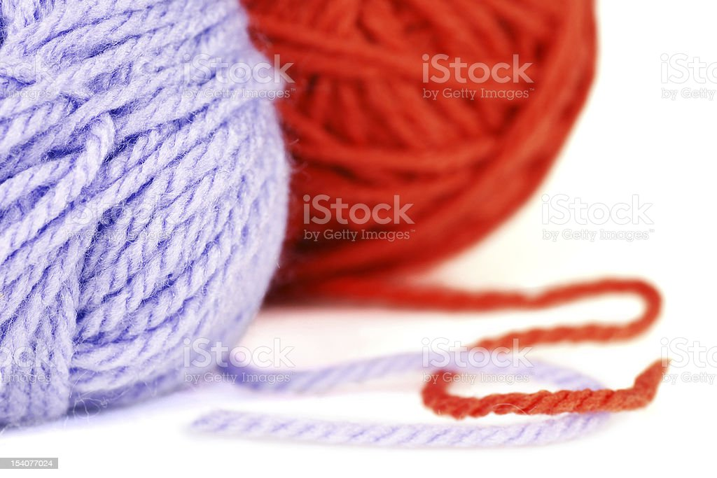 Balls of purple and orange yarn or wool royalty-free stock photo