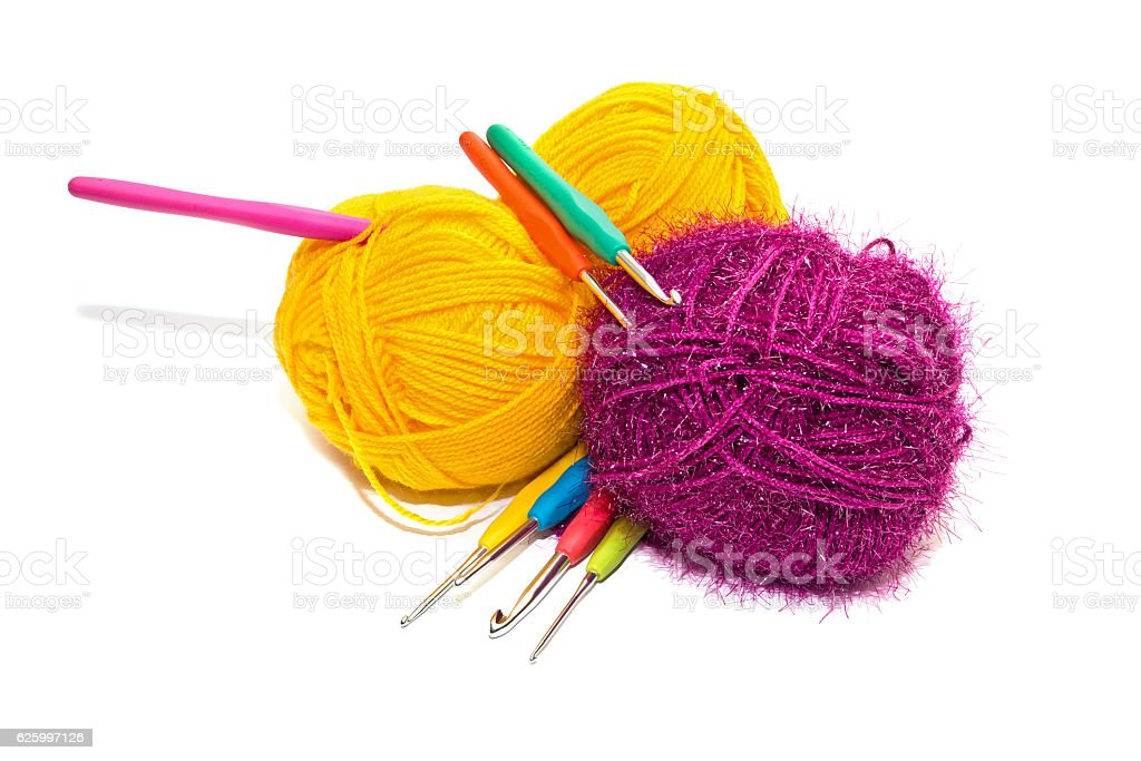 Balls of skein and special hooks stock photo