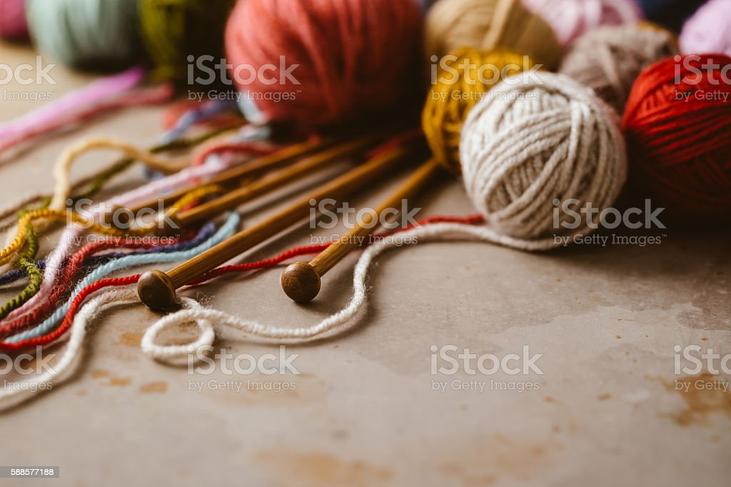 Balls of wool and knitting needles stock photo