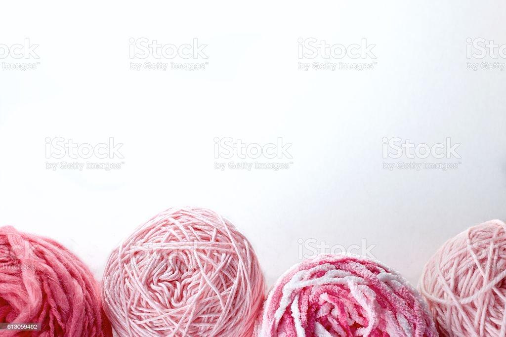 Balls of wool cotton silk yarn set on copy space stock photo