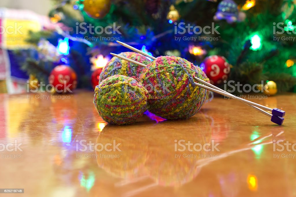 Balls of yarn and knitting needles. stock photo