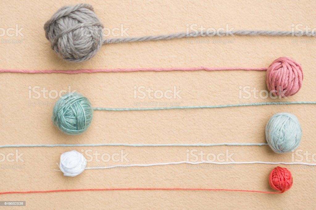 Balls of Yarn of Various Colors with Trailing Strands stock photo