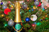 balls on  New Year tree and   bottle of sparkling wine