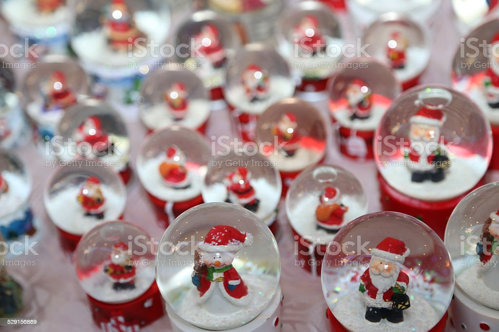 balls with water inside and Santa Claus as Christmas decoration stock photo