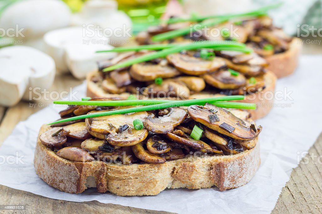 Balsamic mushrooms and green onion bruschetta stock photo