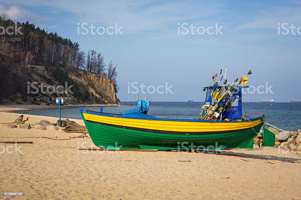 Baltic beach with fishing boat at Orlowo cliff, Poland stock photo