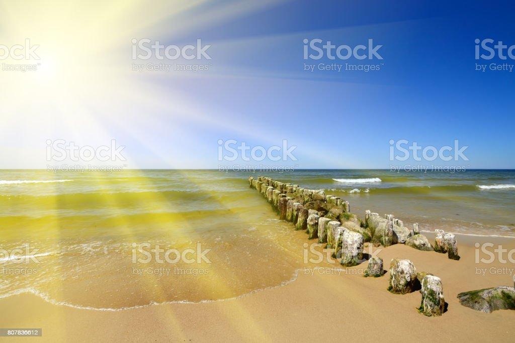 Baltic coast, the sun and the breakwater stock photo