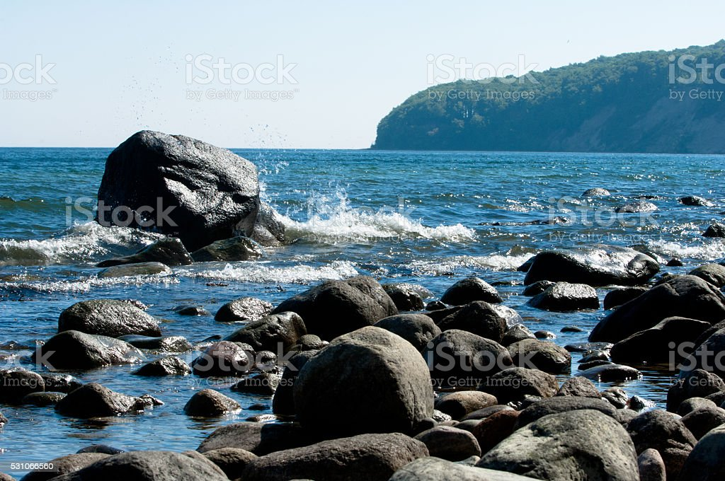 Baltic coastline with big rocks and braking waves stock photo