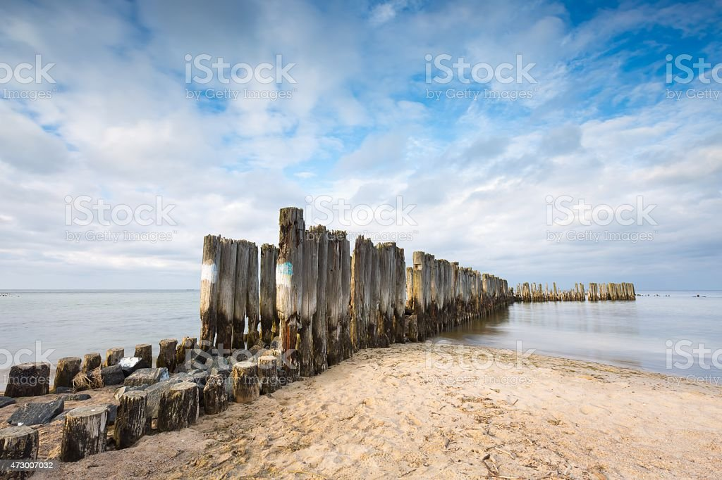 Baltic sandy coast with old military buildings stock photo