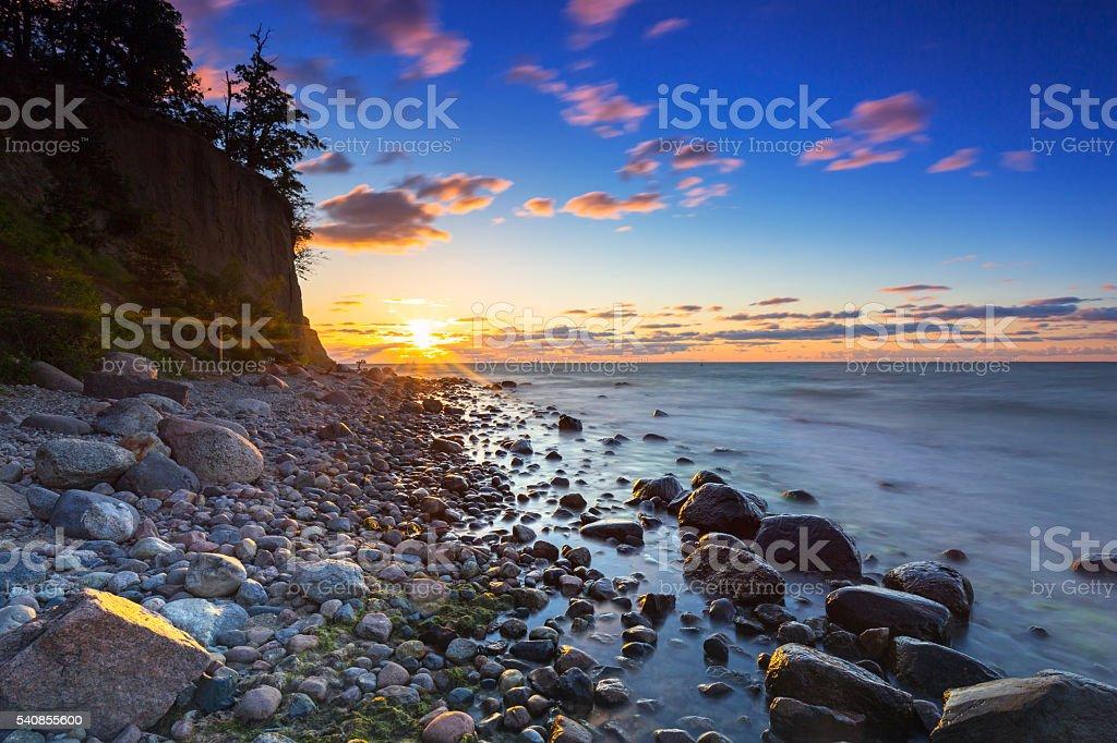 Baltic sea and Cliff of Orlowo at sunrise, Poland stock photo