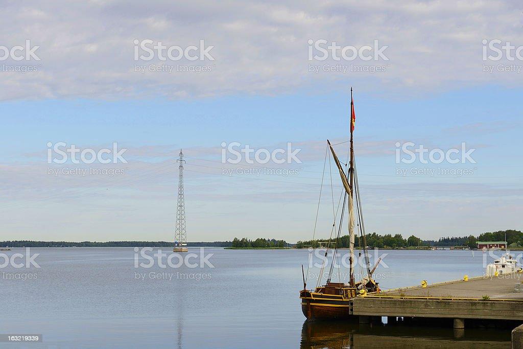 Baltic Sea, old pier and board tar-fragrant Postyacht stock photo