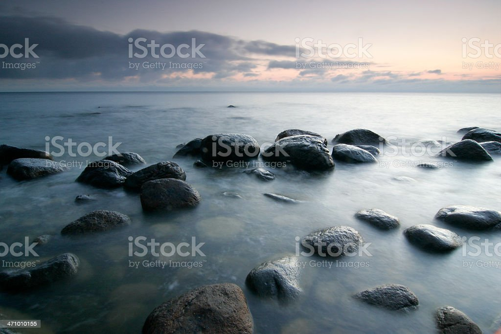 Baltic Sea with Boulders and Rocks in Water at Dawn royalty-free stock photo
