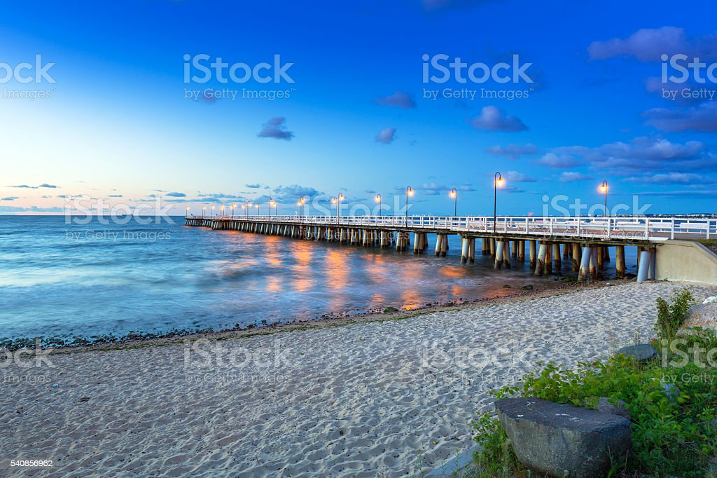 Baltic sea with pier in Gdynia Orlowo at sunrise, Poland stock photo
