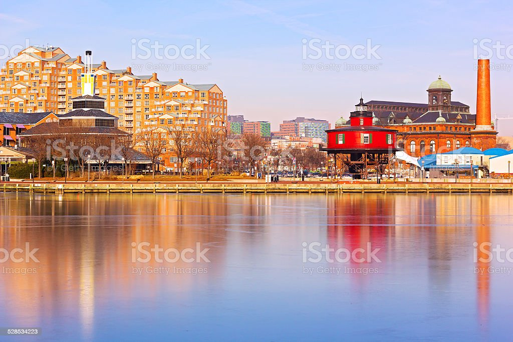 Baltimore harbor and the Seven Foot Knoll Lighthouse at sunset. stock photo