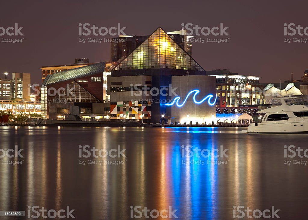 Baltimore's Inner Harbor and National Aquarium Lit at Night royalty-free stock photo