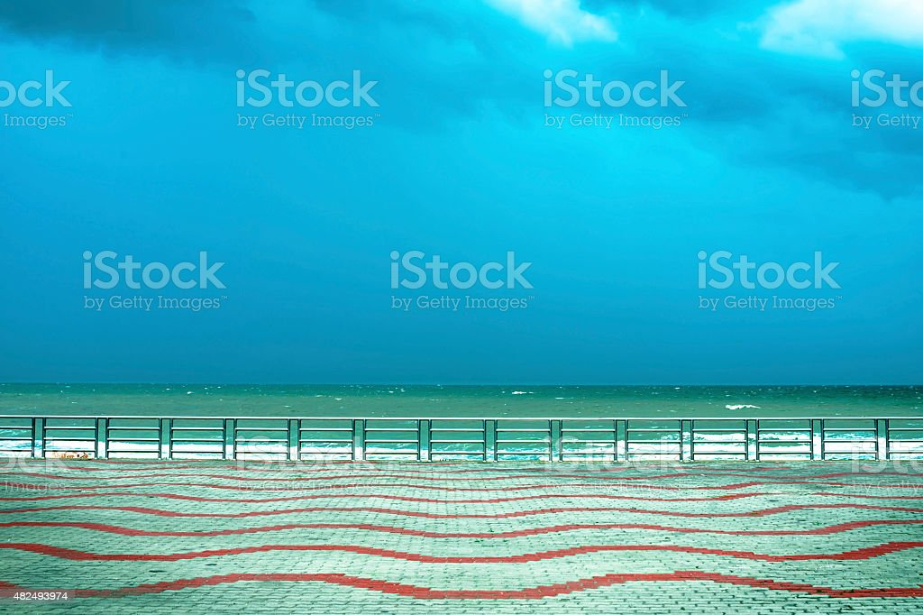 Balustrade and empty terrace overlooking the sea royalty-free stock photo