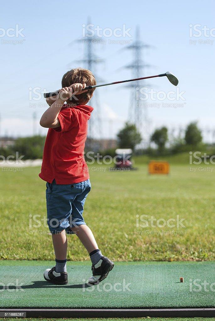Bambino e il golf stock photo