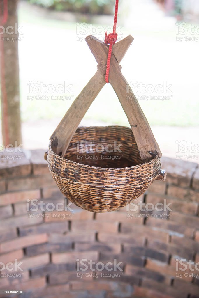 Bamboo Basket for dip up water at Nam Hoo Temple stock photo