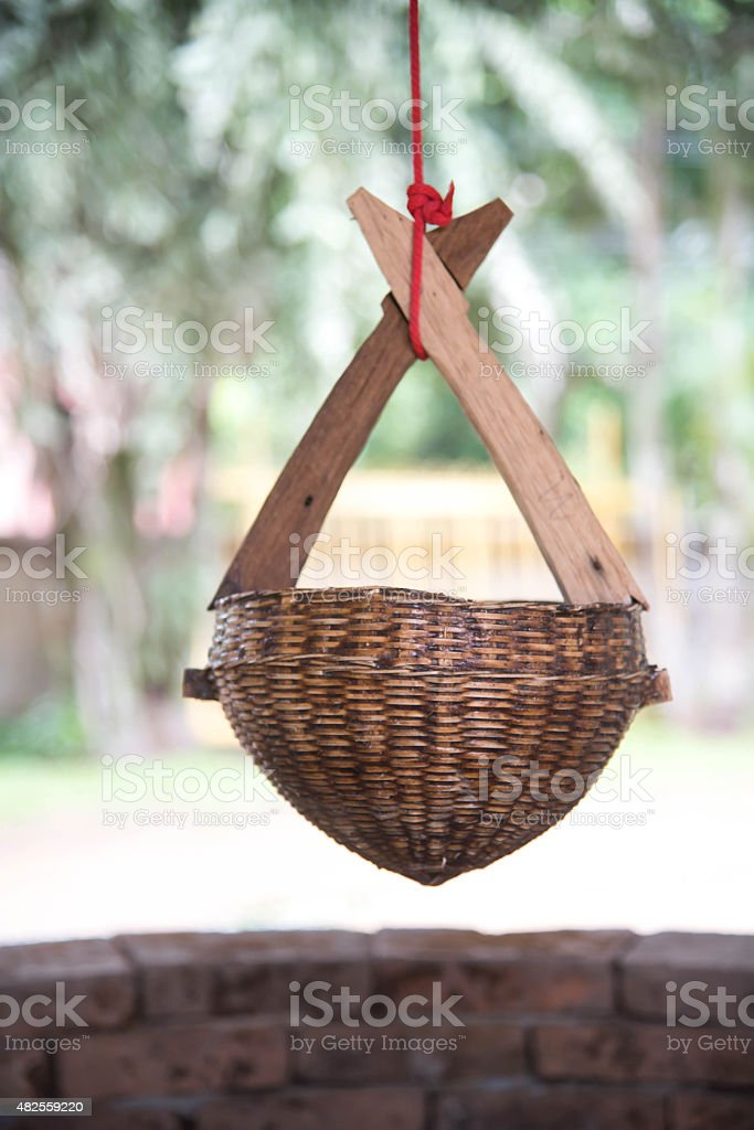 Bamboo Basket for dip up water at Nam Hoo Temple, stock photo