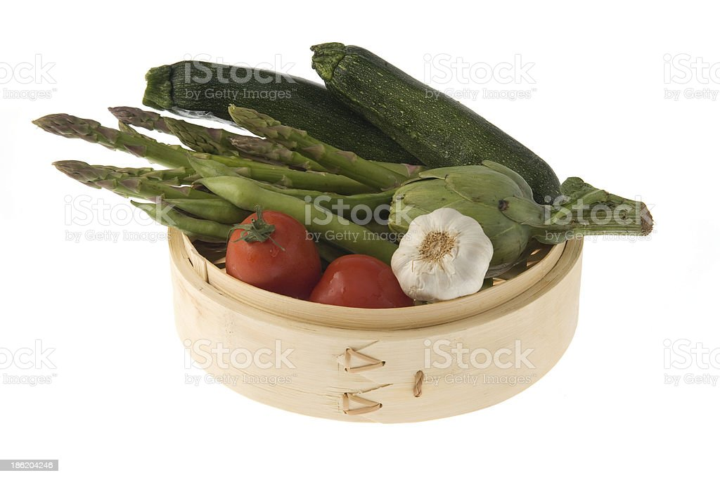 Bamboo basket with vegetables royalty-free stock photo