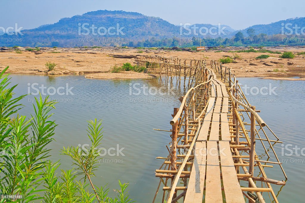 Bamboo bridge across the river royalty-free stock photo