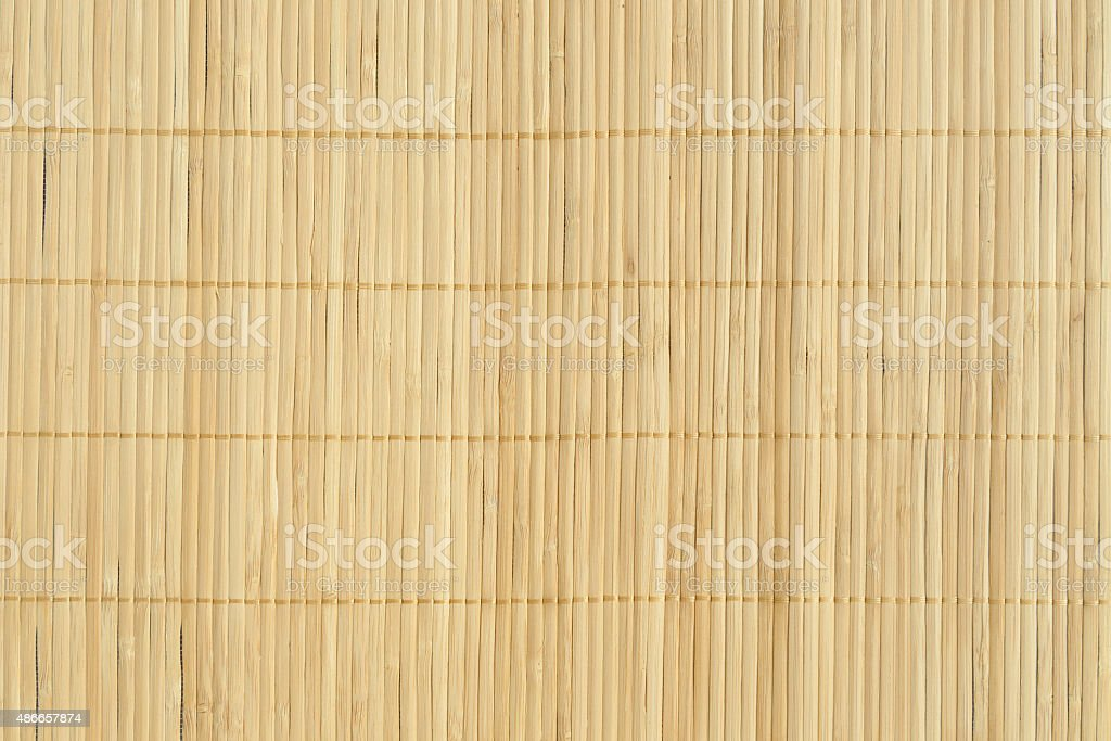 Bamboo brown straw mat as abstract texture background compositio stock photo