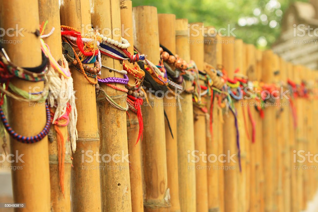 Bamboo Fence Wrapped in Wristbands stock photo