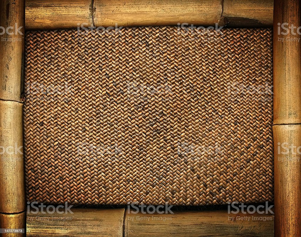 bamboo frame on rattan background stock photo
