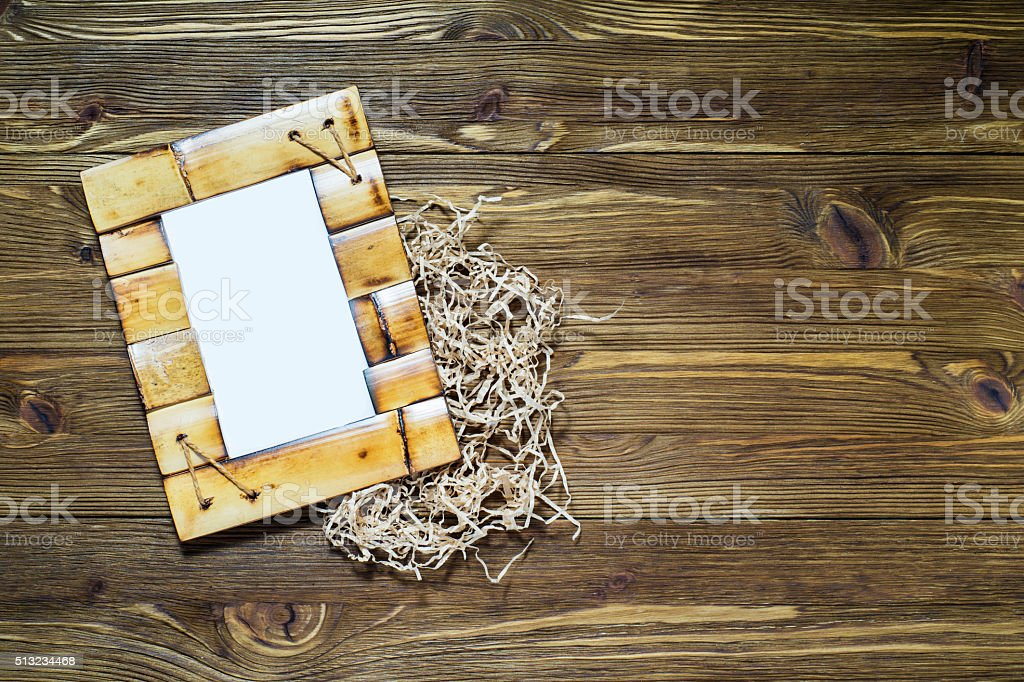 Bamboo frame on wooden background. stock photo