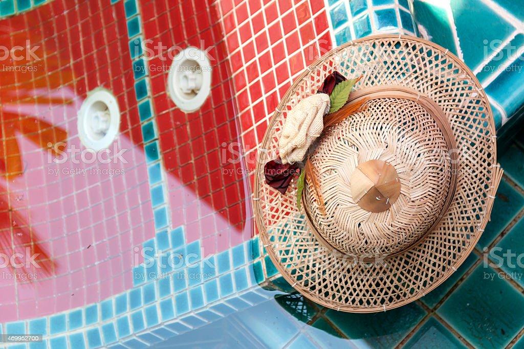 bamboo hat at pool royalty-free stock photo