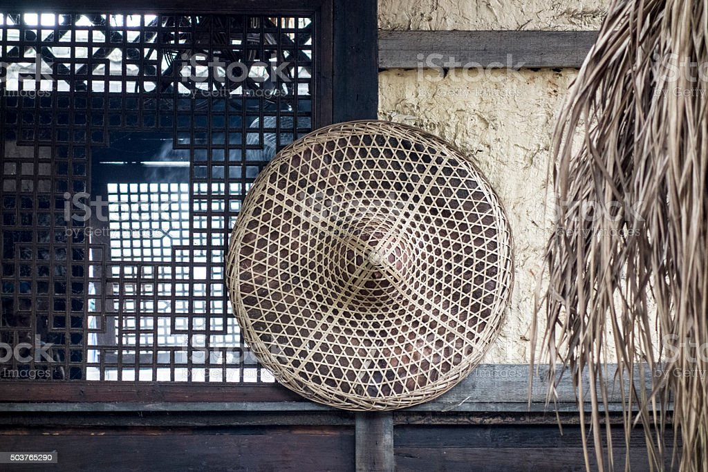 bamboo hat on the wall stock photo