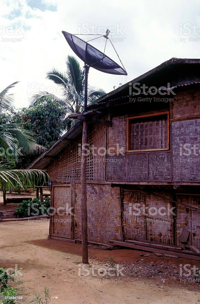 Bamboo house with satellite dish royalty-free stock photo