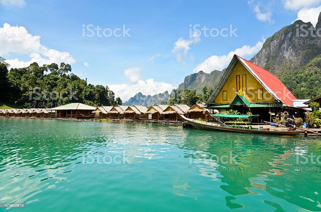 Bamboo huts at a floating tropical resort stock photo