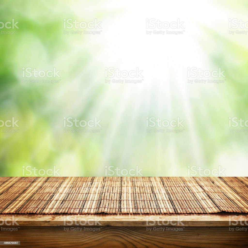A Bamboo Mat Placed On An Empty Table Outside In The Sun Royalty Free Stock