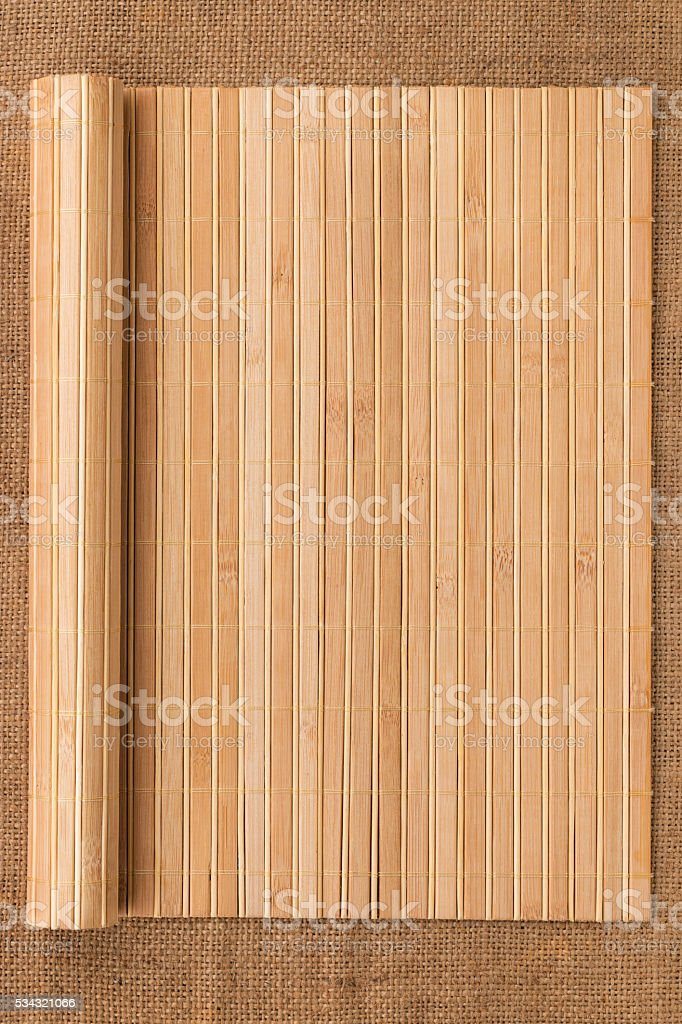 Bamboo mat twisted in the form of a manuscript stock photo