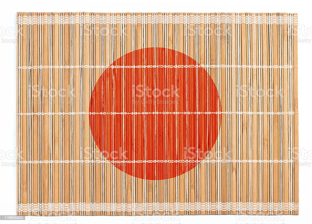 Bamboo placemat colored as Japanese flag isolated on white royalty-free stock photo