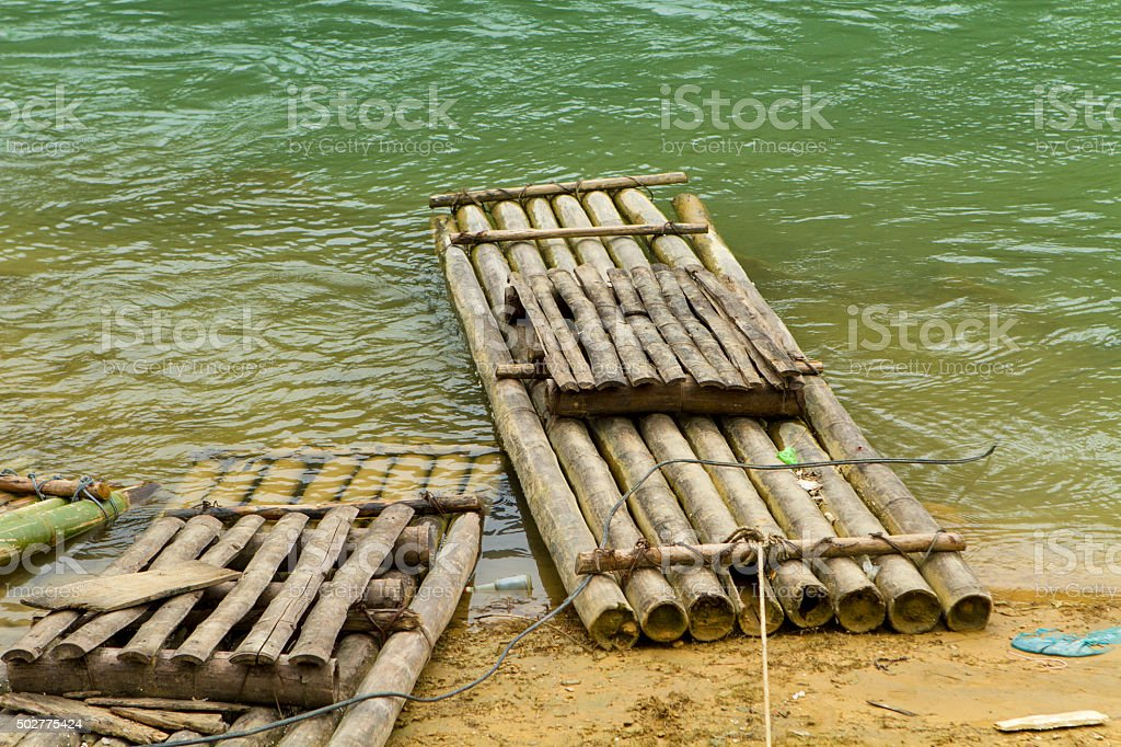 Bamboo raft floating stock photo